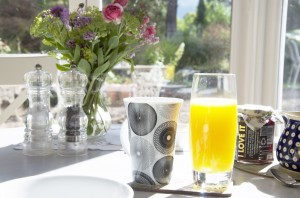 Drinks ready for a sunny breakfast in the garden dining room at Upper Newton Farmhouse
