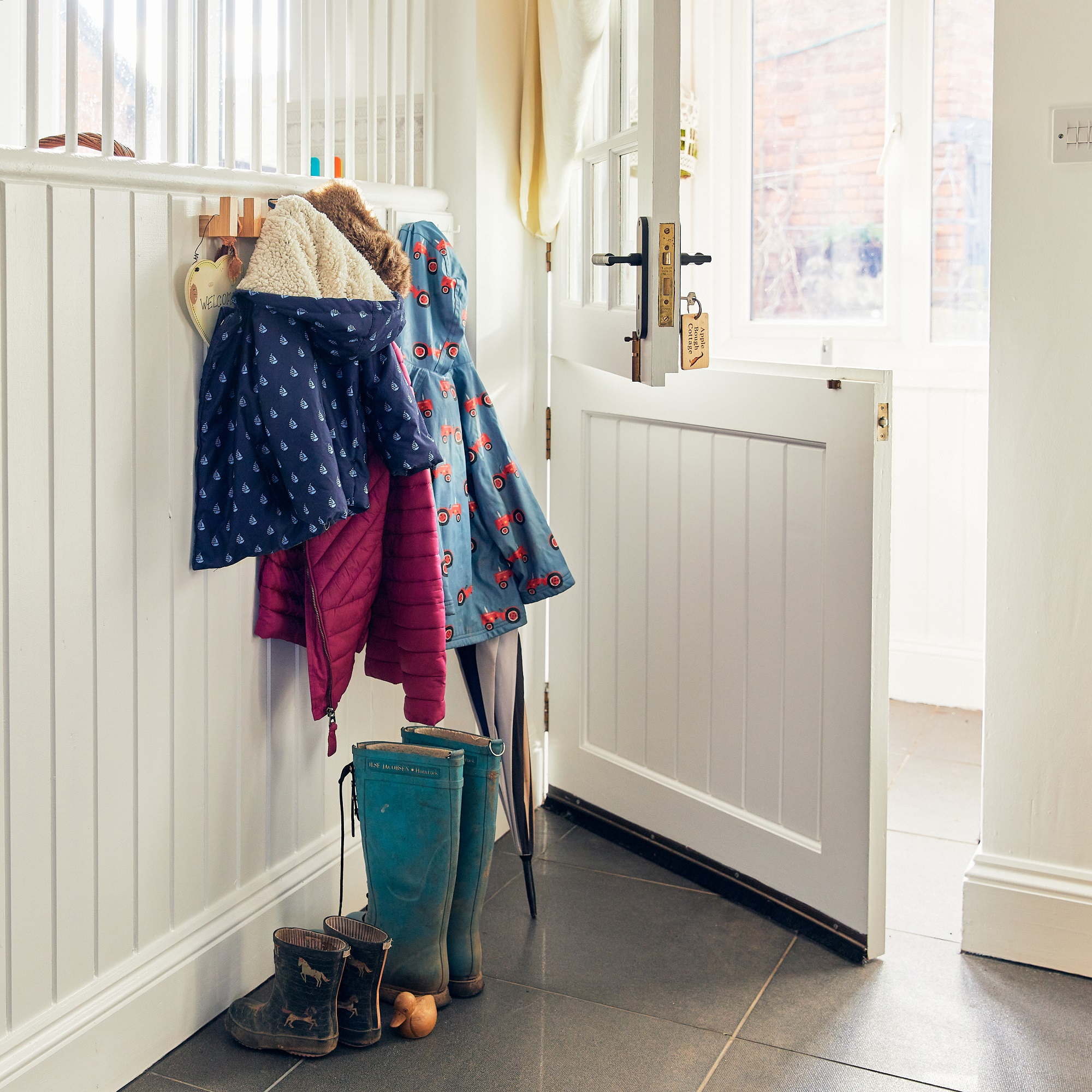 Stable door, Joules clothing and wellingtons, in Apple Bough Cottage, Upper Newton Farm, Herefordshire Holidays