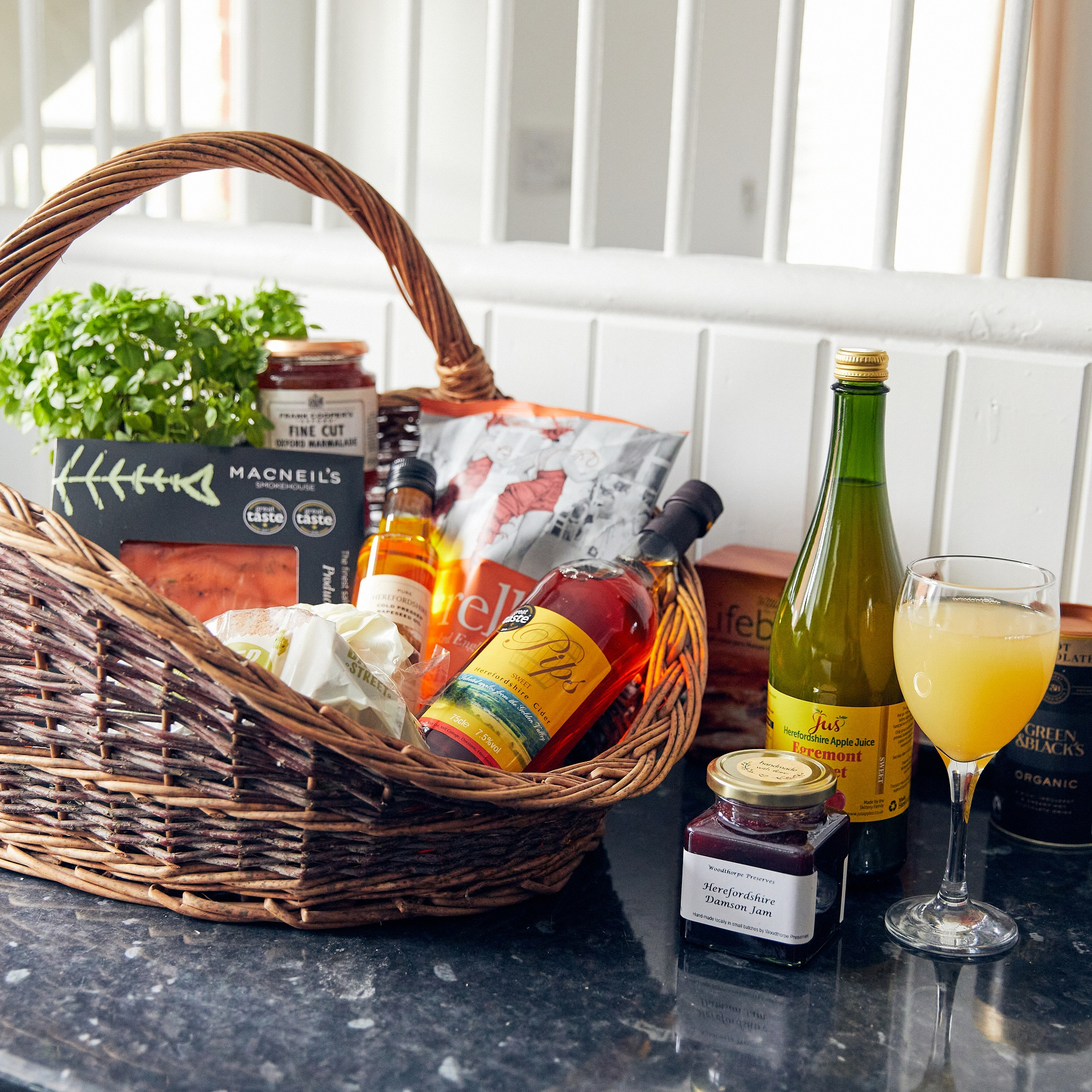 Basket of local produce, apple juice, jams, smoked salmon, cider, chutneys, sauces, cheese, at Apple Bough Cottage, Upper Newton Farm, Herefordshire Holidays
